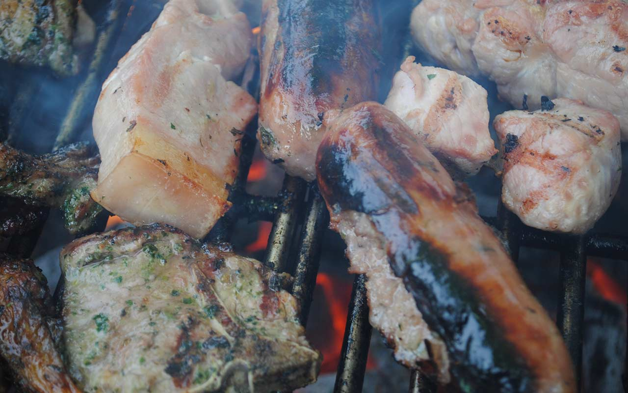 Quality sausages and burgers sizzling on the BBQ